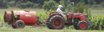 Worker applying pesticide